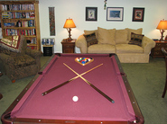 Vacation rental game room with pool table and entrance to hot tub deck